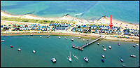 BNPS.co.uk (01202 558833)<br /> Pic: StephenBath/BNPS<br /> <br /> Hut 78 on Mudeford.<br /> <br /> Britain's most expensive beach hut?<br /> <br /> A luxury beach hut has gone on the market for &pound;280,000 - despite having no running water, mains electricity or toilet.<br /> <br /> The wooden cabin is on the exclusive Mudeford Spit in Christchurch, Dorset, which is home to the most expensive beach huts in the country.<br /> <br /> The price tag on this one beats the previous highest at the same sandy spit, Hut 128 - a similar cabin which sold for &pound;275,000 earlier this year.<br /> <br /> The remote sandbank can only be accessed by foot, novelty land train or ferry but its isolated position is what gives it its exclusivity.