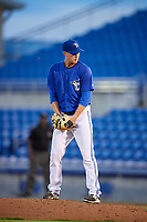 Dunedin Blue Jays relief pitcher Jonathan Cheshire (18) gets ready to deliver a pitch during a game against the Jupiter Hammerheads on August 14, 2018 at Dunedin Stadium in Dunedin, Florida.  Jupiter defeated Dunedin 5-4 in 10 innings.  (Mike Janes/Four Seam Images)