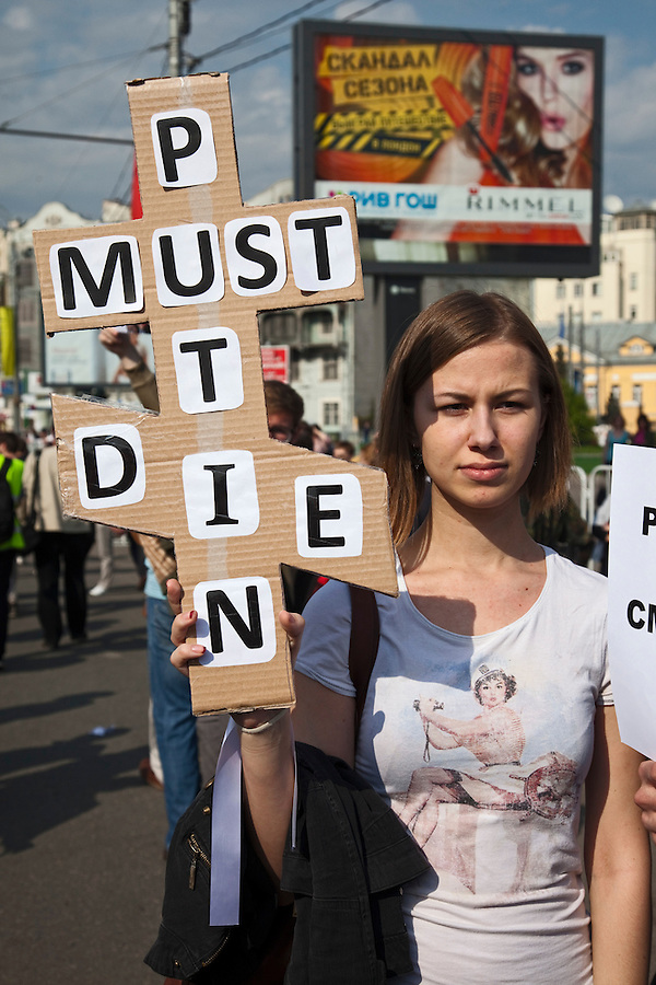 "Moscow, Russia, 06/05/2012..A woman with the words ""Putin must die"" in the shape of a Russian Orthodox cross at opposition demonstration against Russian Presidential election results on the eve of Vladimir Putins inauguration as President."