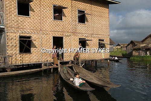Extended family house made of Rattan built on stilts Inle Lake. Myanmar (Burma.) 2006.  .