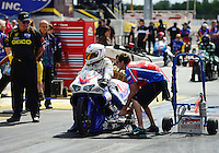 Sept 9, 2012; Clermont, IN, USA: NHRA crew member for pro stock motorcycle rider Hector Arana Jr during the US Nationals at Lucas Oil Raceway. Mandatory Credit: Mark J. Rebilas-