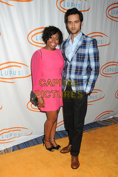 Brandee Tucker & Michael Steger.12th Annual Lupus LA Orange Ball held at the Beverly Wilshire Hotel, Beverly Hills, California, USA..May 24th, 2012.full length black trousers blue plaid tartan check jacket suit pink married husband wife dress.CAP/ADM/BP.©Byron Purvis/AdMedia/Capital Pictures.