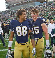 Wide receiver Corey Robinson (88) and tight end Troy Niklas (85) celebrate the win.