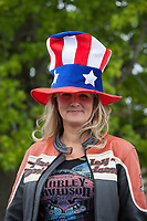 Woman Harley-Davidson rider wearing large red, white and blue patriotic hat, Independence Day Parade 2016, Burien, Washington, USA.