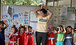 Christian Love Daroy-Gagno, the program director of the Kapatiran-Kaunlaran Foundation (KKFI), sings with children in a KKFI-sponsored preschool in Pulilan, a village in Bulacan, Philippines.<br /> <br /> KKFI is supported by United Methodist Women.