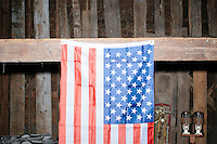 American flags hang in the barn before satirical presidential candidate Vermin Supreme delivers a stump speech at Ten Rod Farm in Rochester, New Hampshire. Supreme's platform advocates a pony-based economy, using zombies to solve the energy crisis, and other outlandish ideas. Supreme has been on the New Hampshire primary ballot in 2008 and 2012, though he has been running for president in 1992. Vermin Supreme will be on the Democratic party ballot in the 2016 New Hampshire primary.