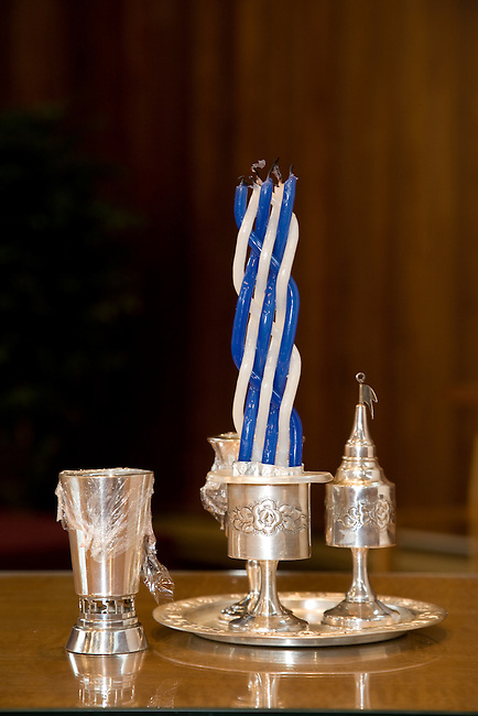 Havdalah candle, kiddish cup and other ceremonial objects used to celebrate the end of the Jewish sabboth.