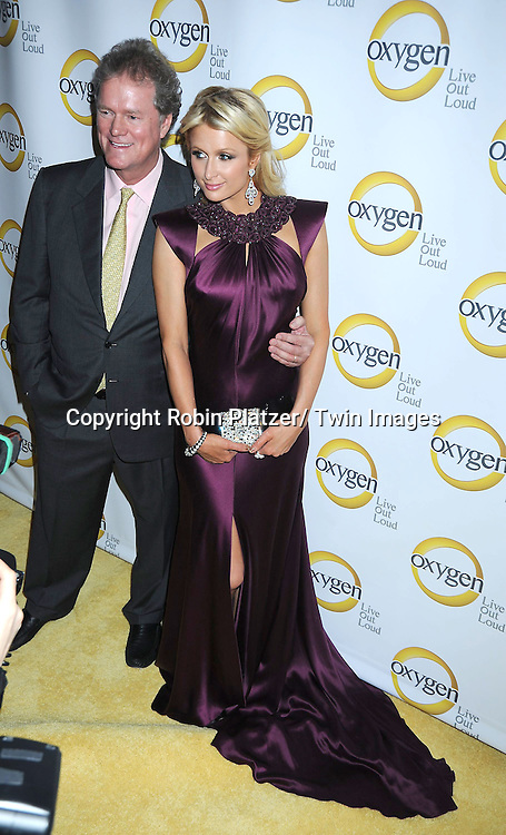 Rick Hilton and daughter Paris Hilton attending the Oxygen Upfront on April 4, 2011 at Gotham Hall in New York City.