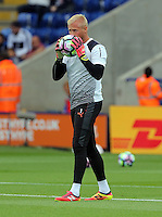 Pictured: Kasper Schmeichel of Leicester City  bites a sticker off a football Saturday 27 August 2016<br /> Re: Swansea City FC v Leicester City FC Premier League game at the King Power Stadium, Leicester, England, UK