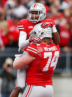 Ohio State Buckeyes wide receiver Philly Brown (10) celebrates with Ohio State Buckeyes offensive linesman Jack Mewhort (74) after his touchdown in the second quarter the NCAA football game between the Ohio State Buckeyes and the Iowa Hawkeyes at Ohio Stadium in Columbus, Saturday afternoon, October 19, 2013. The Ohio State Buckeyes defeated the Iowa Hawkeyes 34 - 24.  (The Columbus Dispatch / Eamon Queeney)