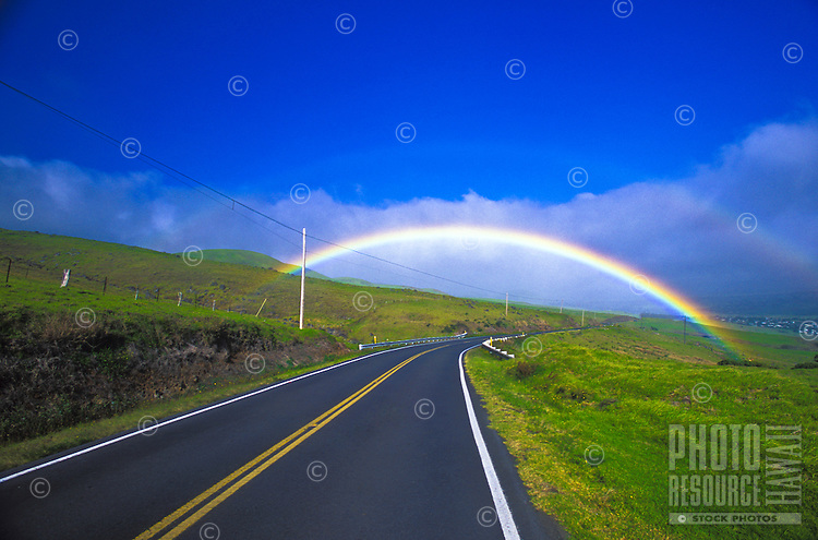 Double rainbow over the road from Hawi to Waimea in North Kohala on the Big island of Hawaii