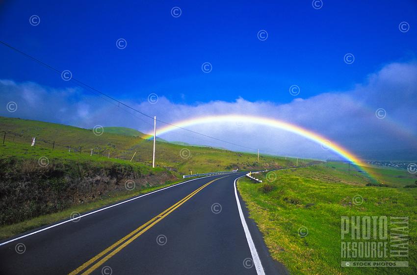 Double rainbow over the road from Hawi to Waimea in North Kohala on the Big island of Hawaii