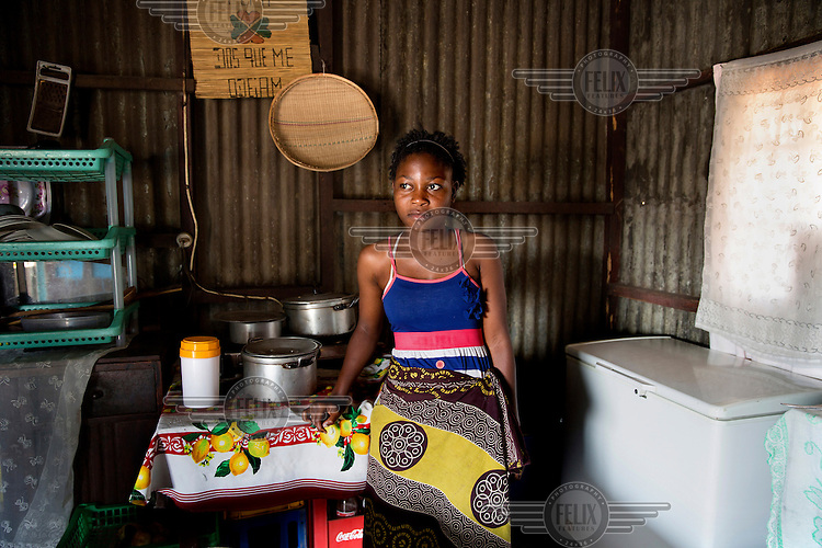 Assucena Guamba (14) in the kitchen of her corrugated iron shack in Chamanculo D.