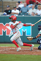 Zeke White (3) of the Greeneville Reds follows through on his swing against the Pulaski Yankees at Calfee Park on June 23, 2018 in Pulaski, Virginia. The Reds defeated the Yankees 6-5.  (Brian Westerholt/Four Seam Images)