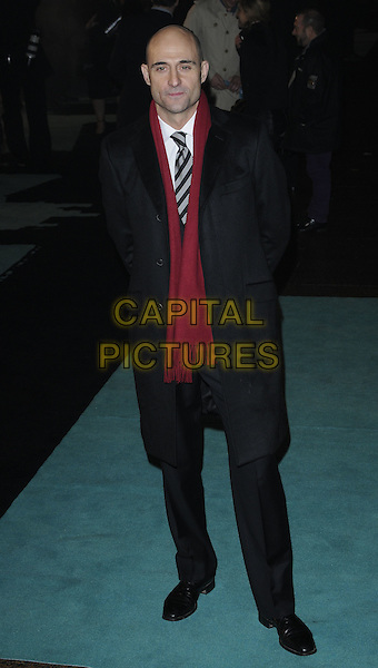 "MARK STRONG.The World Premiere of ""Sherlock Holmes"", Empire cinema Leicester Square, London, England..December 14th, 2009.arrivals full length red scarf tie black striped stripes gloves coat grey gray trousers .CAP/CAN.©Can Nguyen/Capital Pictures."
