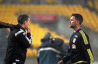 Phoenix coaches Chris Greenacre (left) and Des Buckingham during the A-League football match between Wellington Phoenix and Adelaide United at Westpac Stadium in Wellington, New Zealand on Sunday, 1 January 2017. Photo: Dave Lintott / lintottphoto.co.nz