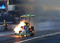 Feb 12, 2016; Pomona, CA, USA; NHRA top fuel driver Leah Pritchett has an engine fire during qualifying for the Winternationals at Auto Club Raceway at Pomona. Mandatory Credit: Mark J. Rebilas-USA TODAY Sports