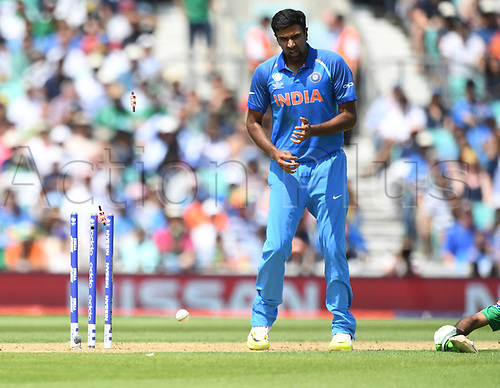 June 18th 2017, The Kia Oval, London, England;  ICC Champions Trophy Cricket Final; India versus Pakistan; A direct hit does not run out Fakhar Zaman of Pakistan watched by Ravichandran Ashwin of India