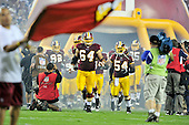 Washington Redskins defensive end Kedric Golston (64) and linebacker H.B. Blades (54) lead their team onto the field prior to their game against the Dallas Cowboys at FedEx Field in Landover, Maryland on Sunday, September 12, 2010. .Credit: Ron Sachs / CNP