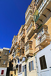 Balconies of historic houses in city centre of Valletta, Malta