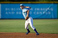 Burlington Royals second baseman Brian Bien (3) makes a throw to first base against the Danville Braves at Burlington Athletic Park on August 13, 2015 in Burlington, North Carolina.  The Braves defeated the Royals 6-3. (Brian Westerholt/Four Seam Images)