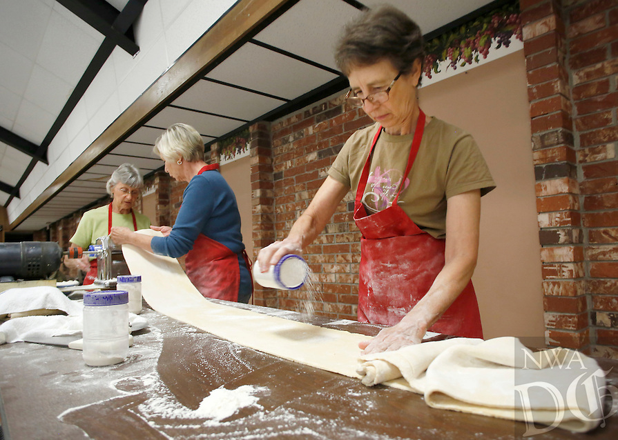 NWA Media/DAVID GOTTSCHALK - 7/10/14 - Jeanette Burditt, left to right, Antoinette Pianalto and Gerrie Hughey roll pasta Thursday July 10, 2014 at the St. Joseph's Parish Hall in Tontitown. The three were volunteering their time participating in making a total of 3,600 pounds of pasta for the 116th Tontitown Grape Festival August 5-9, 2014.
