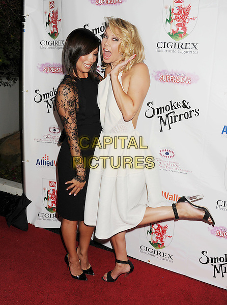 BEVERLY HILLS, CA- SEPTEMBER 13: TV personalities/dancers Cheryl Burke; Kym Johnson attend the Brent Shapiro Foundation for Alcohol and Drug Awareness' annual 'Summer Spectacular Under The Stars' at a private residence on September 13, 2014 in Beverly Hills, California.<br /> CAP/ROT/TM<br /> &copy;Tony Michaels/Roth Stock/Capital Pictures