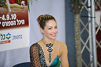 "Irina Risenzon of Israel smiles to cameras at ""kiss & cry"" during event finals at 2010 Holon Grand Prix at Holon, Israel on September 4, 2010.  (Photo by Tom Theobald)."