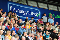 fans of Swansea city infront of the energy check advertising during the Sky Bet Championship match between Swansea City and Nottingham Forest at the Liberty Stadium, in Swansea, Wales, UK. Saturday 15 September 2018