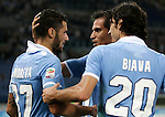 Calcio, Serie A: Lazio vs Milan Roma, stadio Olimpico, 20 ottobre 2012..Lazio midfielder Antonio Candreva, left, celebrates with teammates Cristian Ledesma, center, and Giuseppe Biava, after scoring during the Italian Serie A football match between Lazio and AC Milan, at Rome's Olympic stadium, 20 October 2012..UPDATE IMAGES PRESS/Riccardo De Luca