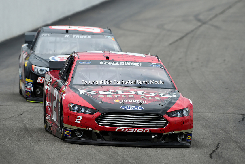 July 13, 2014 - Loudon, New Hampshire, U.S. - Sprint Cup Series driver Brad Keselowski (2) leads driver Ryan Truex (83) into a turn at the NASCAR Sprint Cup Series Camping World RV 301 race held at the New Hampshire Motor Speedway in Loudon, New Hampshire. Eric Canha/CSM