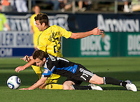 Bobby Convey of Earthquakes fights for the ball against Eric Brunner of the Crew during the first half of the game at Buck Shaw Stadium in Santa Clara, California.  San Jose Earthquakes tied Columbus Crew, 2-2.