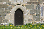 Cornwall, England. Church door with spring flowers.