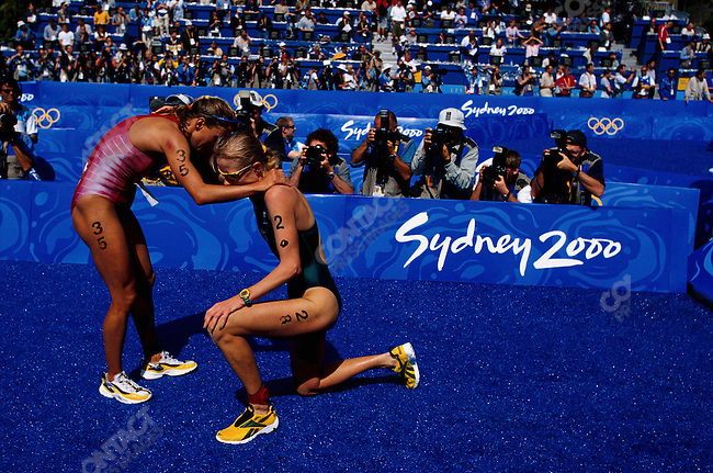 Triathlon, women,  Brigitte McMahon, left, (Switzerland) - gold and Michellie Jones (Australia) - silver, congratulate each other after crossing the finish line. Summer Olympics, Sydney, Australia, September 2000