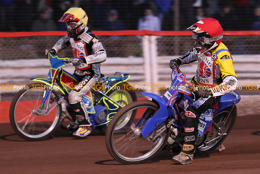 Heat 2: Josh Auty (red) and Kyle Hughes (yellow) - British U21 Speedway Final at the Arena Essex Raceway, Purfleet - 16/04/10 - MANDATORY CREDIT: Rob Newell/TGSPHOTO - Self billing applies where appropriate - 0845 094 6026 - contact@tgsphoto.co.uk - NO UNPAID USE.