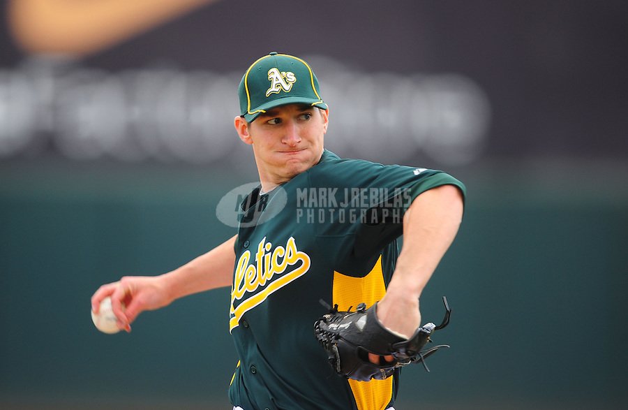 Mar. 19, 2012; Phoenix, AZ, USA; Oakland Athletics pitcher Jarrod Parker throws in the fourth inning against the Arizona Diamondbacks during a spring training game at Phoenix Municipal Stadium.  Mandatory Credit: Mark J. Rebilas-