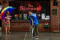 NEW YORK, NY - JUNE 18: People visit the historical landmark Tavern The Stonewall Inn on June 18, 2019 in New York. The Stonewall riots were a series of violent demonstrations by members of the gay (LGBT) community against a police raid starting June 28, 1969, at the Stonewall Inn at the Greenwich Village neighborhood of Manhattan, . (Photo by STRKB/VIEWpress)