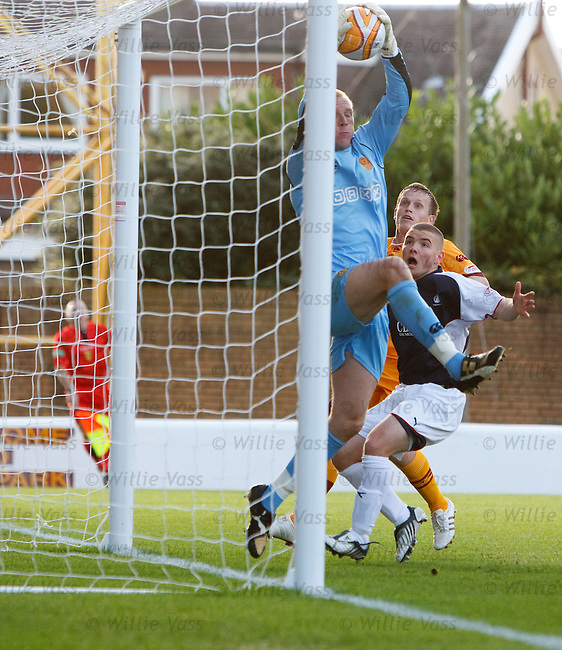 Motherwell keeper John Ruddy plucks the ball off the line as Falkirk appeal it went over