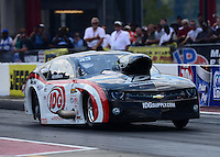 Sept. 15, 2012; Concord, NC, USA: NHRA pro mod driver Rickie Smith during qualifying for the O'Reilly Auto Parts Nationals at zMax Dragway. Mandatory Credit: Mark J. Rebilas-
