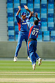Afghanistan V USA cricket in Dubai Sports City Cricket Stadium - Shahpoor Zadran and MOhammed Nabi of Afghanistan celebrate their victory over the US - Picture by Donald MacLeod 11.02.10
