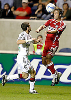 Chicago Fire midfielder Justin Mapp (21) heads the ball in front of DC United midfielder Joshua Gros (17).  The Chicago Fire defeated the DC United 3-0 in the semifinals of the U.S. Open Cup at Toyota Park in Bridgeview, IL on September 6, 2006...