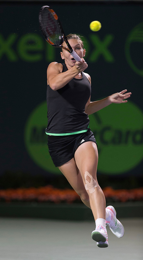 KEY BISCAYNE, FL - April 02: Simona Halep (ROU) in action here loses 26 64 57 to Serena Williams (USA) at the 2015 Miami Open at the Crandon Tennis Center in Key Biscayne Florida.  <br /> Photographer Andrew Patron<br /> <br /> Tennis - 2015 Miami Open presented by Itau - Crandon Park Tennis Center - Key Biscayne, Florida - USA - Day 11, Thursday 2nd April 2015<br /> <br /> &copy; CameraSport - 43 Linden Ave. Countesthorpe. Leicester. England. LE8 5PG - Tel: +44 (0) 116 277 4147 - admin@camerasport.com - www.camerasport.com