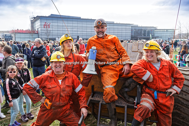 Pictured: An actors speaks to the crowd during The Man Engine show at the Waterfront Museum in Swansea, Wales, UK. Thursday 12 April 2018<br /> Re: The largest mechanical puppet in Britain starts its tour across south Wales.<br /> Man Engine, a mechanical miner which measures 36ft (11m) tall, will appear at the Waterfront Museum in Swansea, Wales, animated by a dozen handlers.<br /> The giant is visiting areas linked to the nation's industrial past.