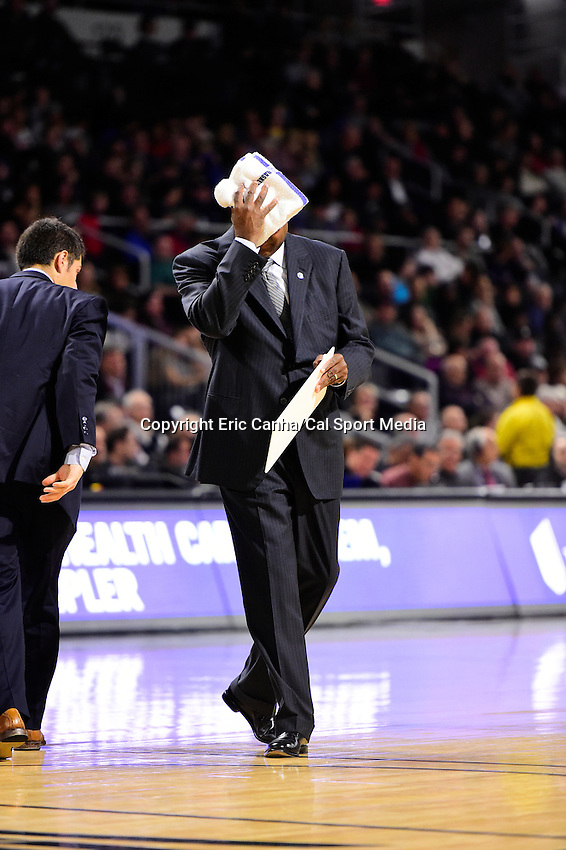 Wednesday, January 4, 2016: Georgetown Hoyas head coach John Thompson III wipes his face during a time out at the NCAA basketball game between the Georgetown Hoyas and the Providence Friars held at the Dunkin Donuts Center, in Providence, Rhode Island. Providence defeats Georgetown 76-70 in regulation time. Eric Canha/CSM