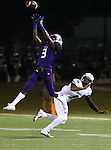 Warren Horne nearly picked off a pass intended for McNeil's Michael Powell Friday at Kelly Reeves Athletic Complex.  The Raiders beat the Mavs 52-7.  (LOURDES M SHOAF for Statesman.)