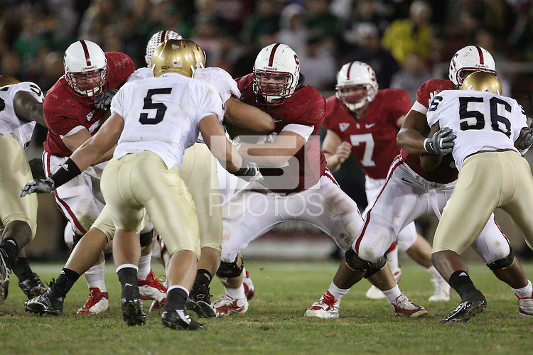 STANFORD, CA - NOVEMBER 28:  Chase Beeler and Andrew Phillips of the Stanford Cardinal block for Toby Gerhart during Stanford's 45-38 win over the Notre Dame Fighting Irish on November 28, 2009 at Stanford Stadium in Stanford, California.