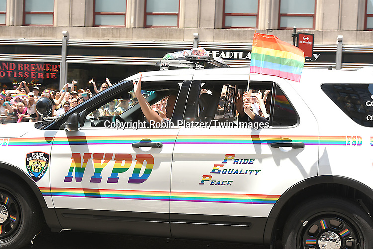 New York City Police Car attends the New York City Gay Pride March 2016 on June 26, 2016 on Fifth Avenue in New York City, New York, USA.<br /> <br /> photo by Robin Platzer/Twin Images<br />  <br /> phone number 212-935-0770