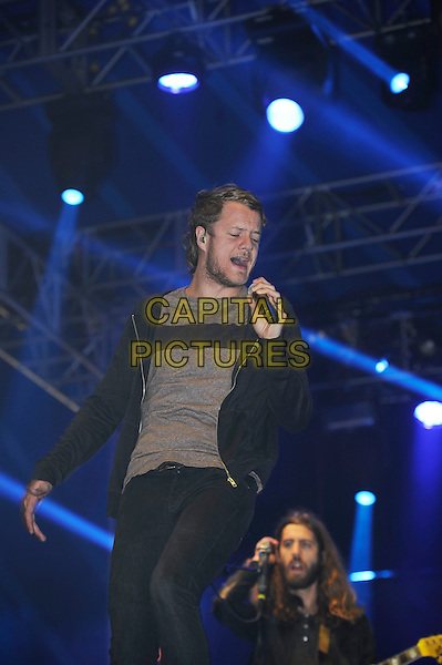 Dan Reynolds<br /> Imagine Dragons performing on the BBC Radio 1/NME stage, Reading Festival, Reading, England. <br /> 24th August 2013<br /> on stage in concert live gig performance performing music half length black jacket top singing grey gray top<br /> CAP/MAR<br /> &copy; Martin Harris/Capital Pictures