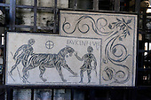 """""""Mosaic with a hunting scene and the inscription ex vicen(nalibus) f(e)l(iciter) veli, which refers to the celebrations of the twentieth year of the reign of the emperor Antoninus Pius (158 d.C.).  The symbol of the theta nigrum refers to the death of the animal, and the V, which can be expanded to vicit, to the victorious huntsman. 2nd Century AD -- Rome - Praetorian Camp"""".  The mosaic, with the explanation, is on display at the Colosseum, also known as the Flavian Amphitheatre, in Rome, Italy on Friday, May 25, 2012..Credit: Ron Sachs / CNP"""