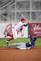 Altoona Curve second baseman Kevin Kramer (37) attempts to turn a double play as Mike Reeves (3) slides in during a game against the New Hampshire Fisher Cats on May 11, 2017 at Peoples Natural Gas Field in Altoona, Pennsylvania.  Altoona defeated New Hampshire 4-3.  (Mike Janes/Four Seam Images)